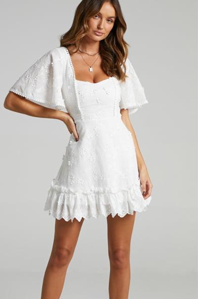 Showpo Fancy a Spritz Dress in White Embroidery